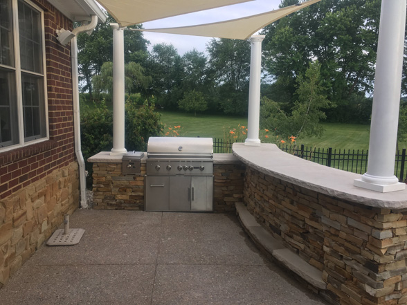outdoor-kitchen-wall-stone-sail-awnings2-jmt-landscapes-patio-paver-landscapers-builder-contractor-unilock-belgard-techo-bloc-natural-stone