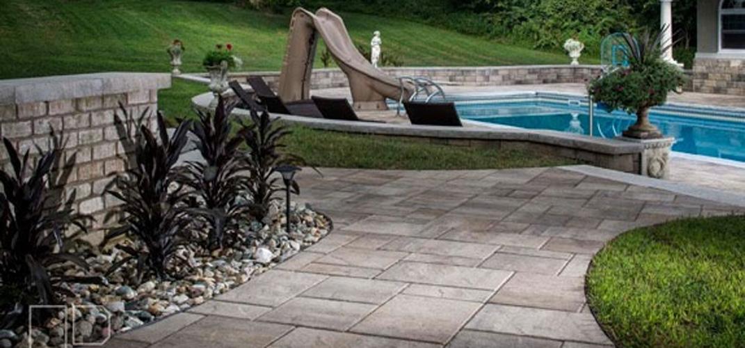 pool-slide-pavers-decorative-rock-jmt-landscapes-patio-paver-landscapers-builder-contractor-unilock-belgard-techo-bloc-natural-stone