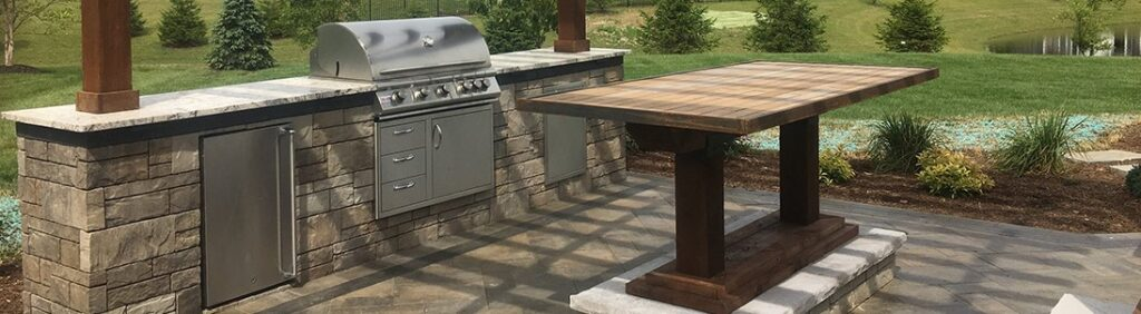 slider-outdoor-kitchen-archedtop-wooden-table-jmt-landscapes-patio-paver-landscapers-builder-contractor